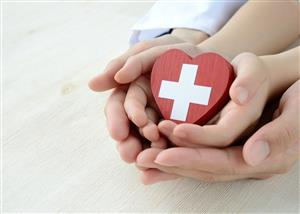 Photo of hands holding a heart to convey good health