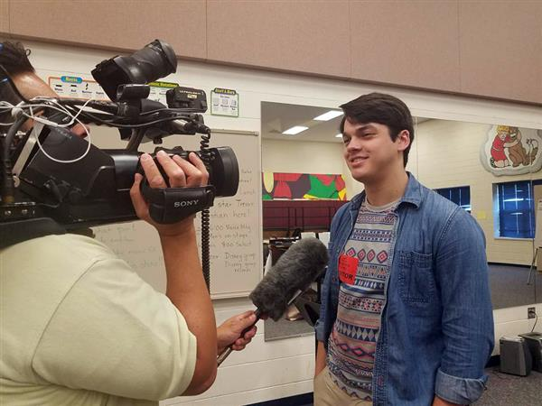 "Trevor McChristian, 2013 Maize High School graduate and star of Music Theatre Wichita ""Newsies,"" visited his alma mater."